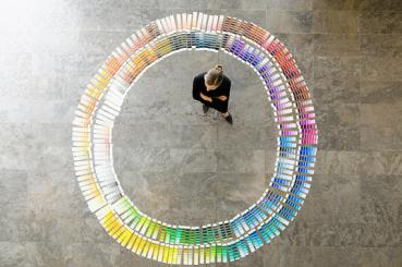 Businesswoman examining paint swatches